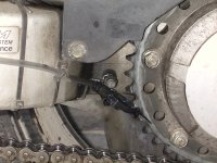 Delivery  widget, front of sprocket and chain